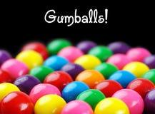 Gumballs no preto Fotos de Stock Royalty Free