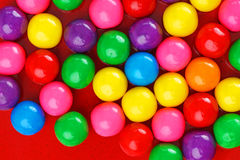 Gumballs on red ceramic Royalty Free Stock Photography