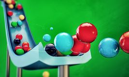 Gumballs sliding down. On green background stock illustration