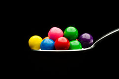 Gumballs on a spoon Royalty Free Stock Photo