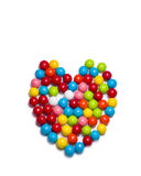 Gumballs on White. Multicolored gumballs arranged in a heart shaped configuration lying on a white background stock image