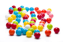 Gumballs on White. Multicolored gumballs sitting in a white background royalty free stock image