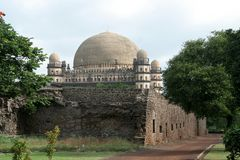 Gumbaz behind Walls. Gol Gumbaz seen behind the walls of nearby structure, Bijapur, Karnataka, India, Asia Stock Photography