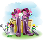 Gumboots and flowers Royalty Free Stock Image