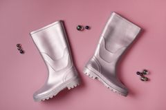 Gumboots and glass balls on pink Stock Image