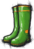 Gumboots. Green gumboots with yellow stripes Royalty Free Stock Photo