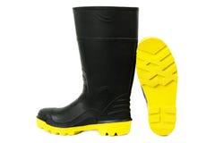 Gumboots negro con los lenguados amarillos Fotos de archivo libres de regalías