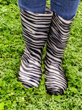 Gumboots in the rain. A close-up view of a pair of gumboots in the rain Stock Images
