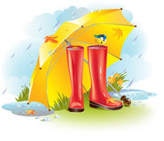 Gumboots under umbrella Stock Photo