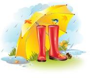 Gumboots under umbrella Stock Photo