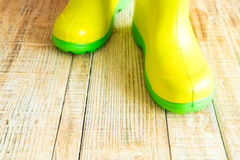 Gumboots on wooden old background. Wall Royalty Free Stock Images