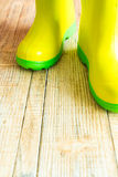 Gumboots on wooden old background. Wall Royalty Free Stock Photos
