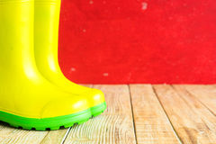 Gumboots on wooden old background. Wall Royalty Free Stock Photography