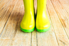 Gumboots on wooden old background. Wall Stock Photography