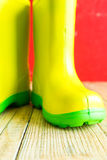 Gumboots on wooden old background Royalty Free Stock Photography