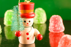 Gumdrop Snowman. A Snowman carrying a tree on ice with a background of gumdrops Stock Photo