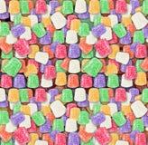 Gumdrops variopinti del fondo senza cuciture di Candy Immagine Stock