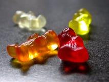 Gummie Bears. Colorful gummie bears on gray surface Stock Photos