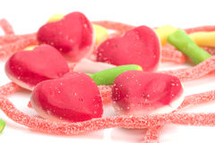 Gummies in the form of hearts. On a white background Royalty Free Stock Photography