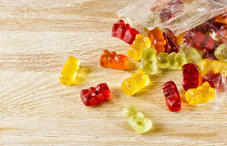Gummies on a wooden table. Multicolored chewing marmalade on the wooden table Stock Photo