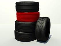 Gummihjul fyra stycken och en red Fotografering för Bildbyråer