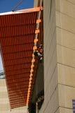 Gummistövelfönsterrengöringsmedel Fotografering för Bildbyråer