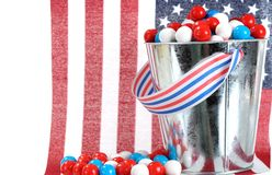 Gummy ball. A pail of gummy ball candy in a Fourth of July decoration stock images