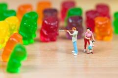 Gummy bear invasion. Junk food concept Stock Images