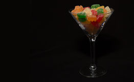 Gummy Bears. Cocktail glass fill with gummy bears. A sweet tasty treat instead of a drink. Colorfully dressing the table of any party Stock Image