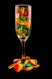 Gummy bears and wine glass on a dark background Royalty Free Stock Photography