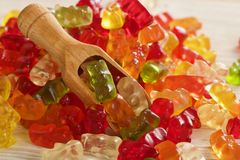 Gummy bears. On wooden background Royalty Free Stock Photography