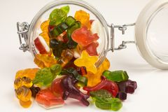 Gummy candy in a glass jar. Gummy candy with different fruit flavors in a glass jar stock image