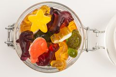 Gummy candy in a jar. Gummy candy with different fruit flavors in a glass jar royalty free stock image