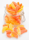 Gummy orange and lemon in glass jar Royalty Free Stock Images