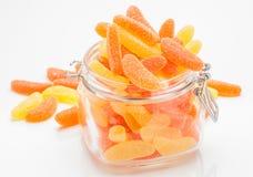 Gummy orange and lemon in glass jar Royalty Free Stock Photo