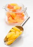Gummy orange and lemon in glass jar Stock Photo