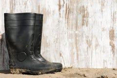 Gumowi buty na plaży Obraz Stock
