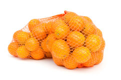 Gumquat in mesh bag on white isolated Royalty Free Stock Photos