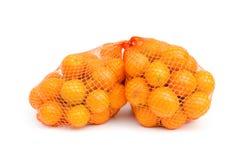 Gumquat in mesh bag on white isolated Stock Photos