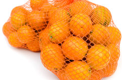 Gumquat in mesh bag on white isolated Royalty Free Stock Image