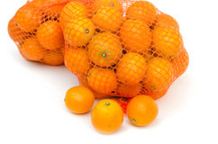 Gumquat in mesh bag on white isolated Royalty Free Stock Images