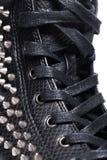 Gumshoe on the white background. Fashion. Black gumshoe on the white background Stock Photography