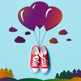 Gumshoes with abstract balloons Stock Photo