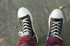Gumshoes. On the background of the asphalt pavement Royalty Free Stock Photo