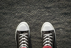 Gumshoes. On the background of the asphalt pavement Stock Photo