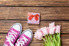 Gumshoes and gift box with tulips Royalty Free Stock Images