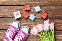 Gumshoes and gift box with tulips Royalty Free Stock Photos