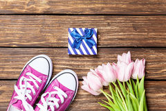 Gumshoes and gift box with tulips Royalty Free Stock Image