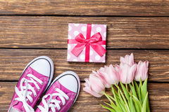 Gumshoes and gift box with tulips Stock Images