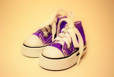 Gumshoes. In purple isolated on purple background Stock Photos